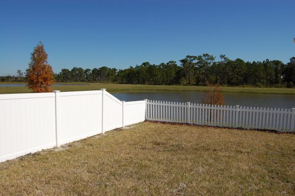 white fence by pond