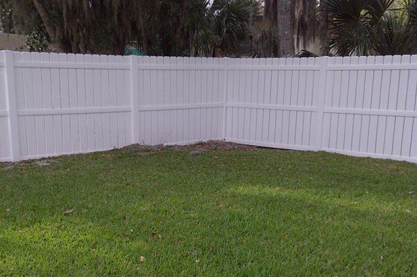 white fence around yard